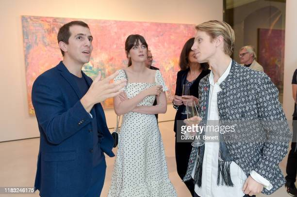 Sassan BehnamBakhtiar Millie Brady and Charley Palmer Rothwell attend a private view of EXTREMIS by Sassan BehnamBakhtiar on October 24 2019 in...
