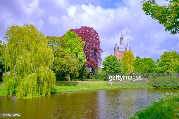 "sassenpoort in the city of zwolle, overijssel during a springtime day with clouds in the background - ""sjoerd van der wal"" or ""sjo"" stock pictures, royalty-free photos & images"