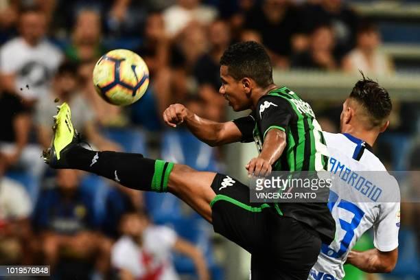 Sassuolo's Brazilian defender Rogerio clears a ball under pressure from Inter Milan's Italian defender Danilo D'Ambrosio during the Italian Serie A...