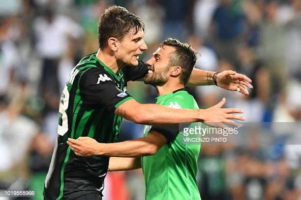 Sassuolo's defender Giangiacomo Magnani embraces Sassuolo's forward Federico Di Francesco at the end of the Italian Serie A football match Sassuolo...