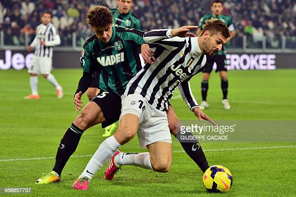 Sassuolo's defender Luca Antei fights for the ball with Juventus' Spanish foward Fernando Torres Llorente during their Serie A match Juventus vs...