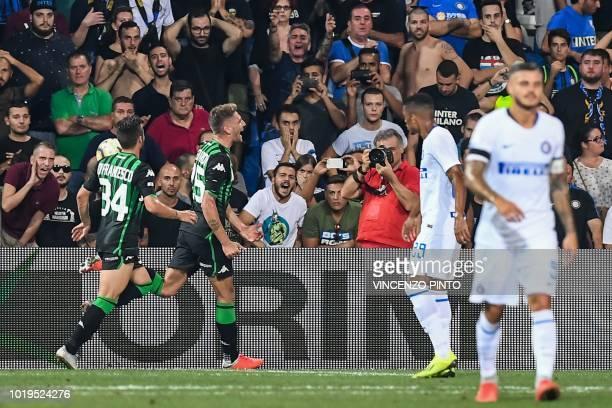 Sassuolo's forward Domenico Berardi celebrates scoring the opening goal during the Italian Serie A football match Sassuolo vs Inter Milan at the...