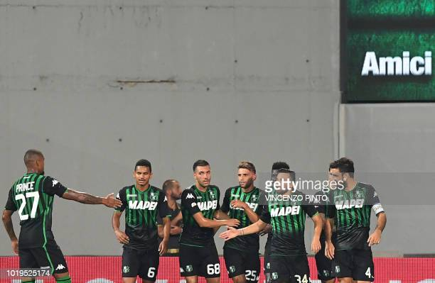 Sassuolo's forward Domenico Berardi celebrates with teammates after opening the scoring during the Italian Serie A football match Sassuolo vs Inter...