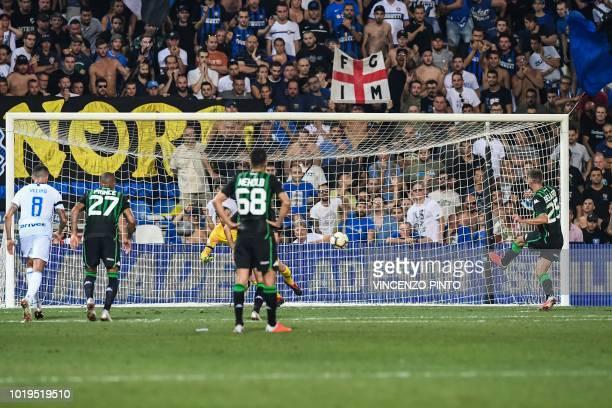 Sassuolo's forward Domenico Berardi kicks a penalty to open the scoring during the Italian Serie A football match Sassuolo vs Inter Milan at the...
