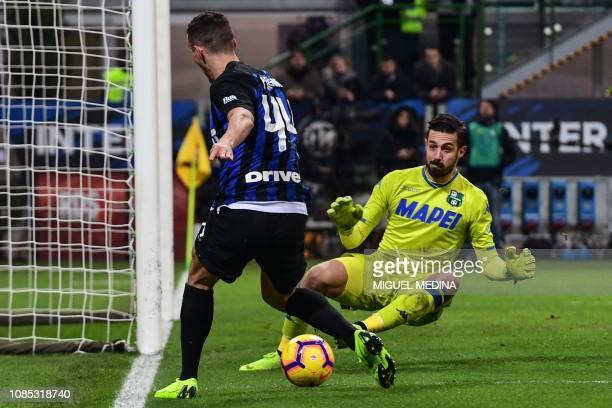 Sassuolo's goalkeeper Andrea Consigli defends against Inter Milan's Croatian midfielder Ivan Perisic during the Italian Serie A football match Inter...