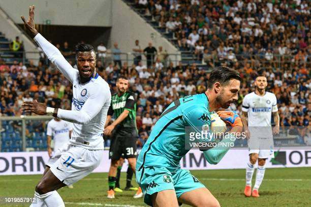 Sassuolo's goalkeeper Andrea Consigli grabs the ball under pressure from Inter Milan's Senegalese forward Keita Balde during the Italian Serie A...