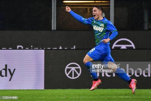 Sassuolo's Italian forward Giacomo Raspadori celebrates after scoring an equalizer during the Italian Serie A football match AC Milan vs Sassuolo on...