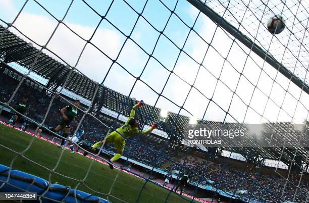 STADIUM NAPLES CAMPANIA ITALY Sassuolo's Italian goalkeeper Andrea Consigli dives as the ball enter the gate after Napoli's striker from France Adam...