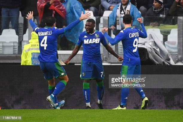 Sassuolo's Ivorian forward Jeremie Boga celebrates with teammates after scoring a goal during the Italian Serie A football match Juventus vs Sassuolo...