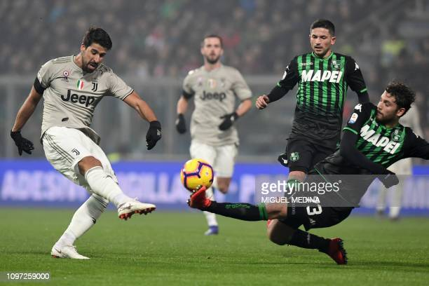 Sassuolo's midfielder Manuel Locatelli defends against Juventus' German midfielder Sami Khedira during the Italian Serie A football match Sassuolo vs...