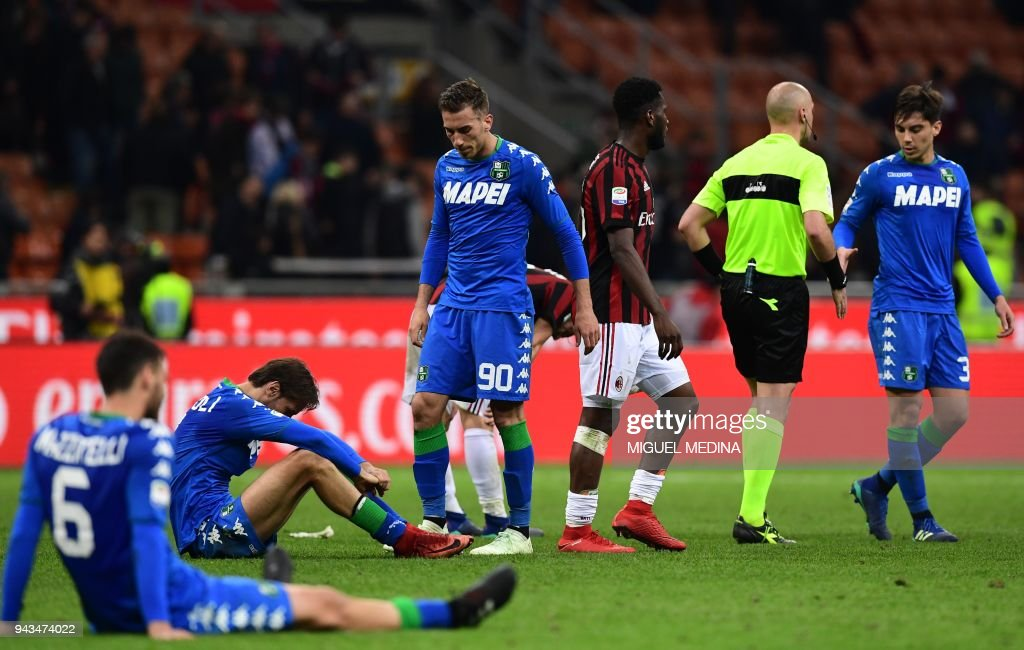 Sassuolo's players react at the end of the Italian Serie A football match between AC Milan and Sassuolo at the San Siro stadium in Milan on April 8, 2018. /