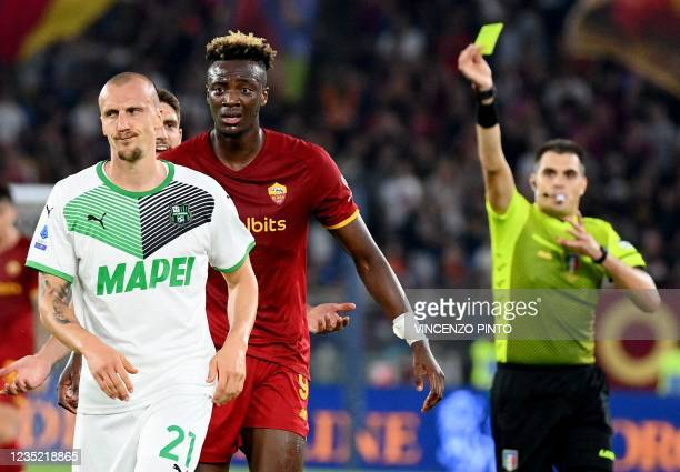 Sassuolo's Romania's defender Vlad Chiriches receives the yellow card after Roma's England's forward Tammy Abraham during the Italian Serie A...