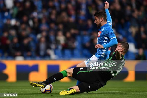 TOPSHOT Sassuolo's Turkish defender Merih Demiral tackles Napoli's Belgian forward Dries Mertens during the Italian Serie A football match Sassuolo...