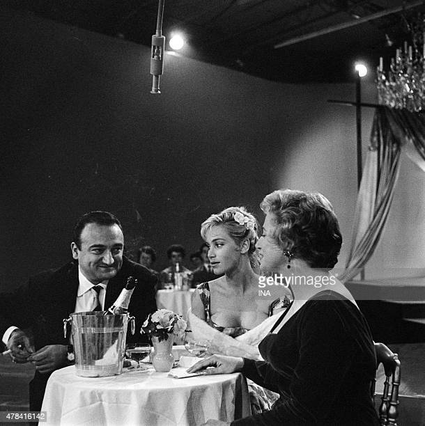 Sat at the table Henri VERNEUIL together with Estella BLAIN and Micheline Sandrel on the set Evening cabaret