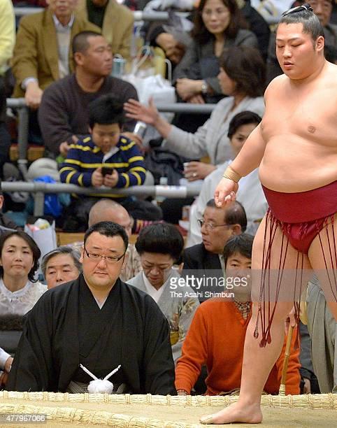 Satable master Otowayama former ozeki Takanonami is seen under the ring during the Grand Sumo Spring Tournament at Osaka Prefecture Gymnasium on...