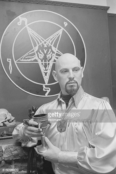 Satan's Church is a Profitable Enterprise Sixfoot LaVey sporting a shaven head and neatly trimmed ming beard stands in front of his magic circle...