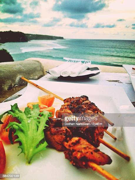 Satay Served On Plate At Beach Restaurant