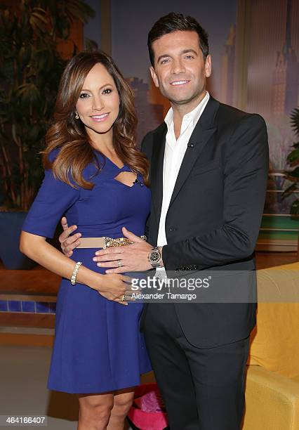 Satcha Pretto and Aaron Butler pose on the set of Univision's Despierta America shortly after announcing that Satcha is pregnant at Univision...
