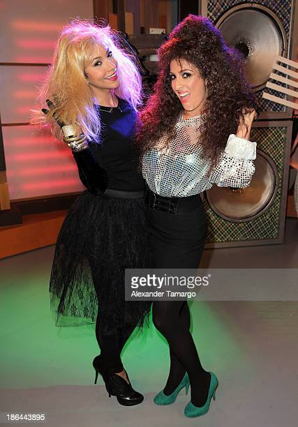 Satcha Pretto and Maity Interiano celebrate Halloween on the set of Univisions 'Despierta America' at Univision Headquarters on October 31 2013 in...