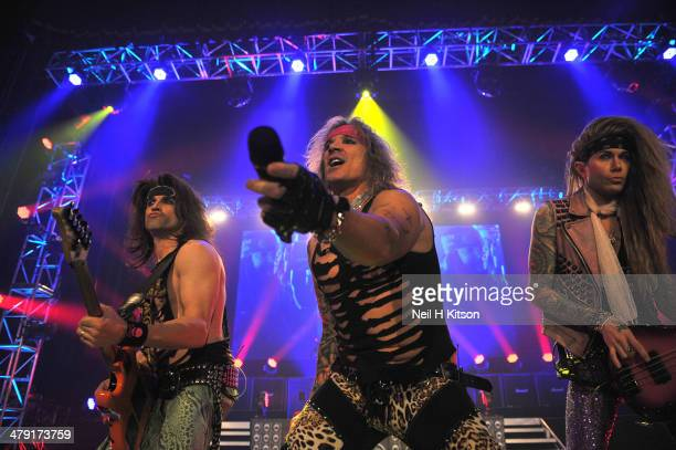 Satchel Michael Star and Lexxi Foxx of Steel Panther performs on stage at Manchester Apollo on March 16 2014 in Manchester United Kingdom