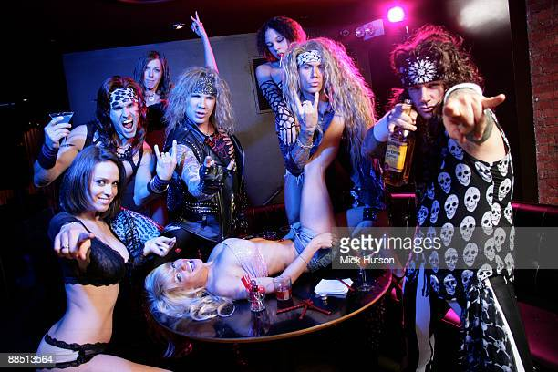 Satchel Michael Starr Lexxi Foxxx and Stix Zadinia of Steel Panther pose with models at the Canal Room on April 1st 2009 in New York