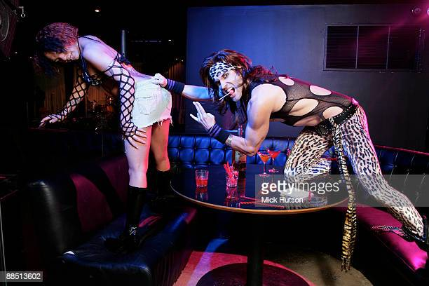 Satchel of Steel Panther poses with model at the Canal Room on April 1st 2009 in New York