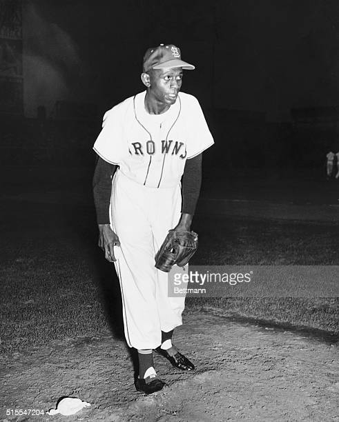 Satchel Paige, famed Negro Leagues pitcher, stands on the pitcher's mound during one of his scoreless performances with the St. Louis Browns of the...