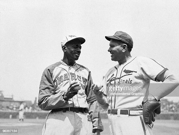 Satchel Paige, left, and Dizzy Dean, pitchers at an exhibition game at Wrigley Field in Chicago compare grips before a game in 1947.