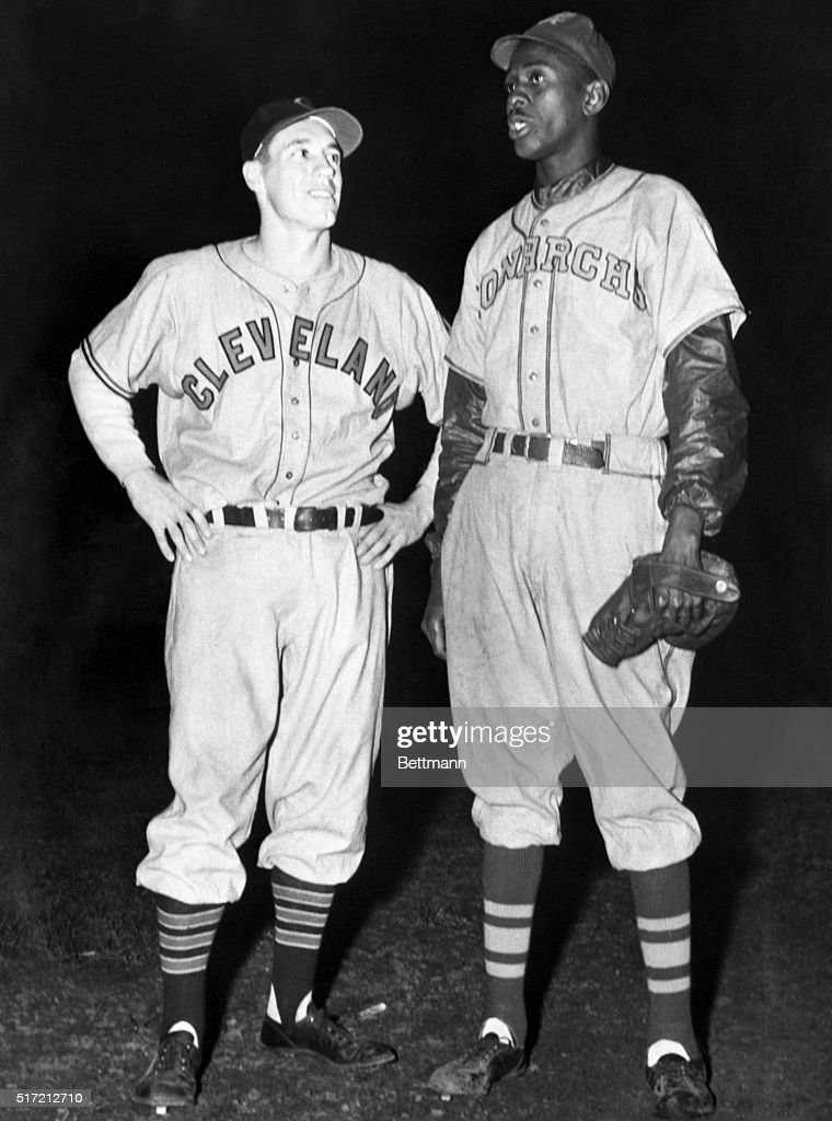 Satchel Paige of the Kansas City Monarchs, a Negro league team, stands with Bob Feller of the Cleveland Indians. The two men led teams of black and white all-stars in two exhibition games.