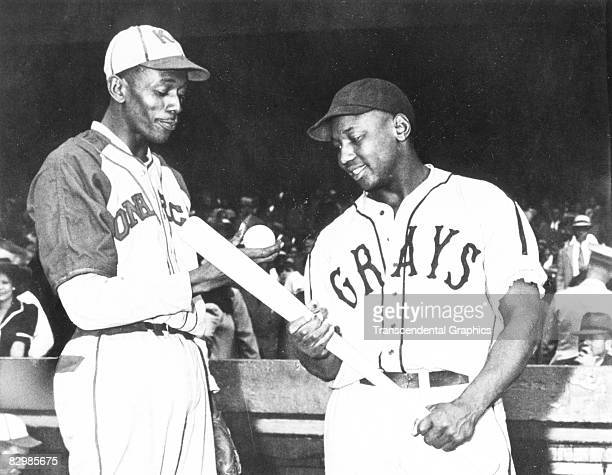 Satchel Paige of the Monarchs talks with Josh Gibson of the Homestead Grays before a game in Kansas City in 1941.