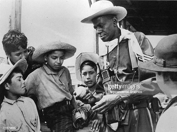Satchel Paige, pitcher for the Monterrey team in the Mexican League, talks to young fans about baseball, and his favorite hobby, photography.
