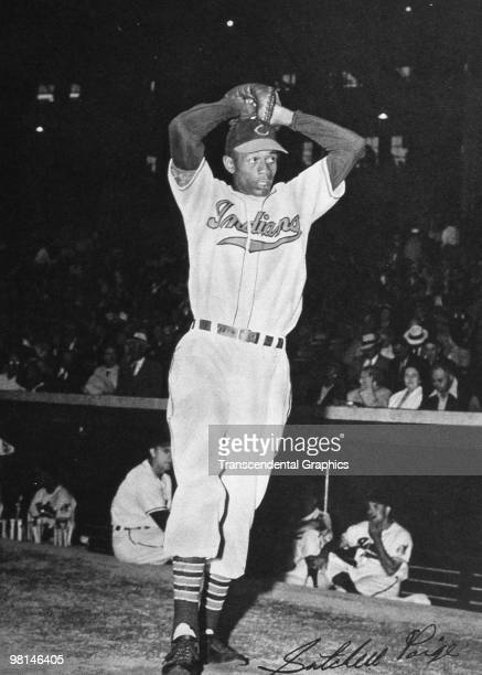 Satchel Paige warms up during a night game at Municipal Stadium in Cleveland in 1948.