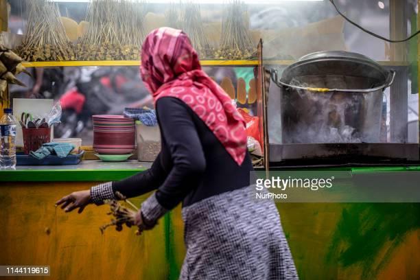 Sate Padang was prepared by a woman for breaking fasting Cullinary food for breaking fasting in Ramadhan at Sabang StreetJakarta