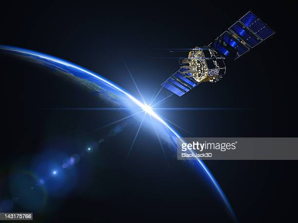 satellite and sunrise in space - copy space stockfoto's en -beelden