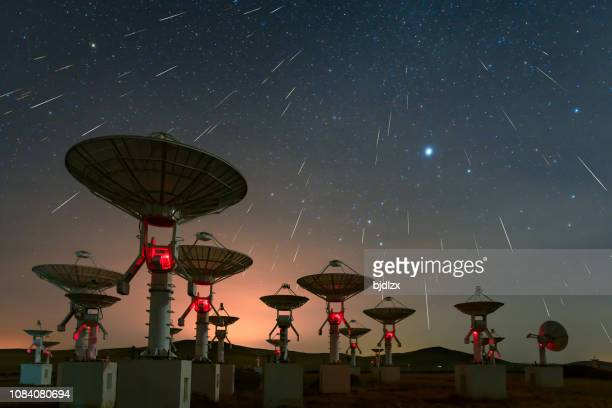 satellite antenna array under the meteor shower - geminid meteor shower stock pictures, royalty-free photos & images