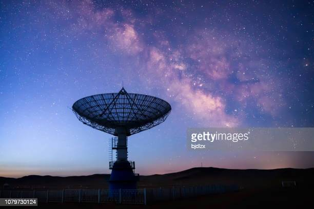 satellite antenna array under the milky way - astrophysics stock pictures, royalty-free photos & images