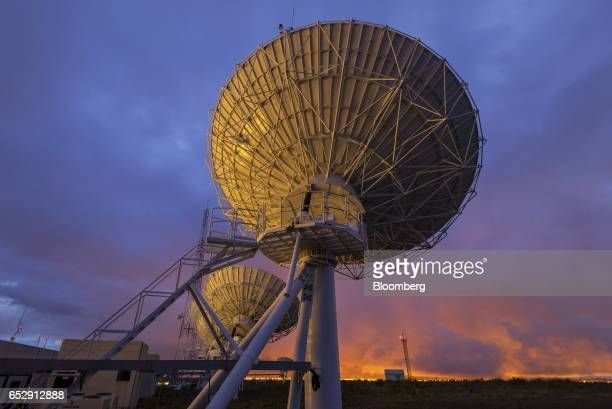 Satellite antennas stand at the Bolivian Space Agency Amachuma Ground Station at sunset in Achocalla La Paz Department Bolivia on Wednesday March 1...
