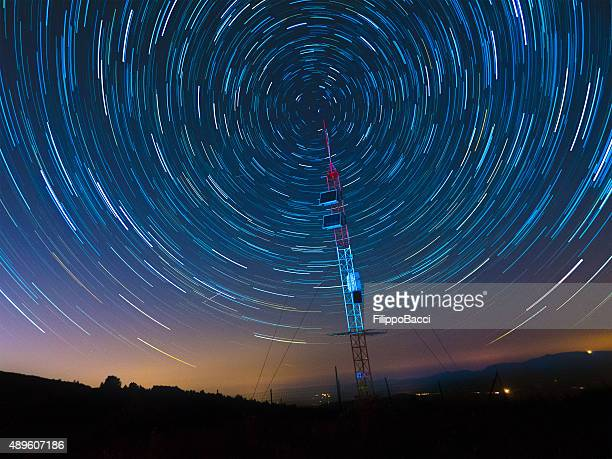 satellite communications under a starry sky - telecommunications equipment stock pictures, royalty-free photos & images