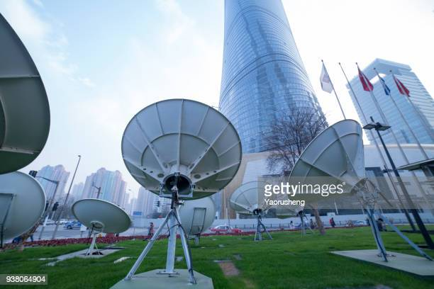 satellite dish antennas in front of the shanghai modern buildings,lujiazui area,china - semaphore stock pictures, royalty-free photos & images