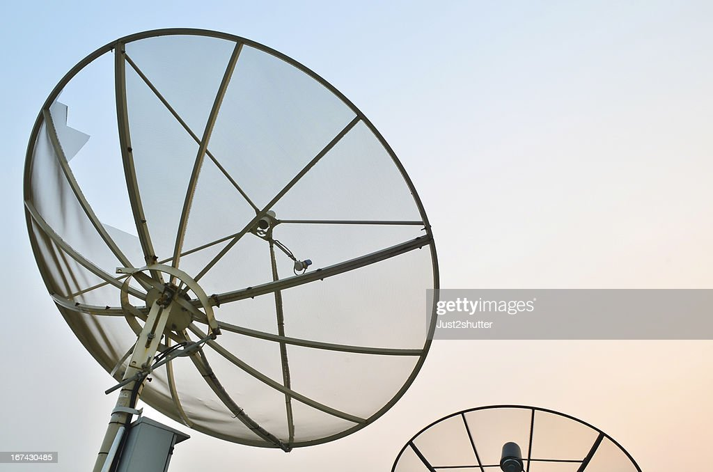 Satellite dish at twilight : Stock Photo