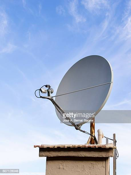 Satellite dish for television on a tower of a building