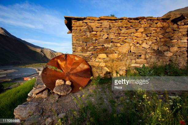 A satellite dish made from the remnants of Russian military equipment dating from the Afghan war of 19791989 lying propped up against a house...