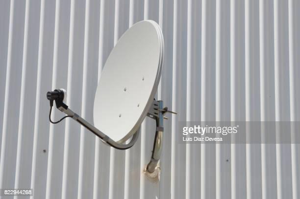 Satellite dish on corrugated iron
