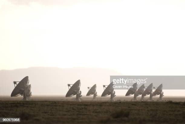 satellite dish on field against sky during foggy weather - national radio astronomy observatory stock pictures, royalty-free photos & images