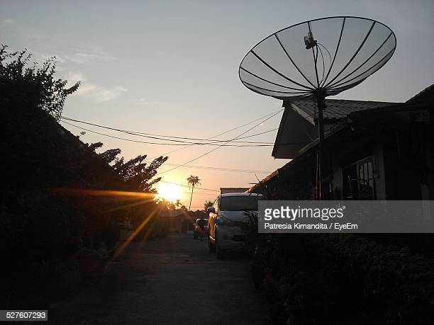 Satellite Dish On House During Sunset