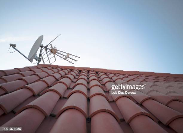satellite dish on roof - solar energy dish stock pictures, royalty-free photos & images