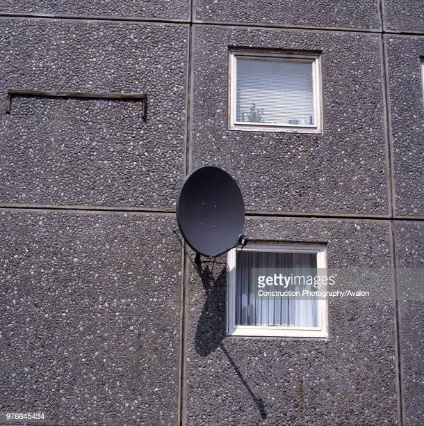 Satellite dish on the facade of a 1970's council tower block Islington London