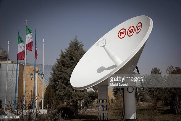 A satellite dish stands in the grounds of the Alborz Station as the media are given their first look inside a control center for the Islamic...