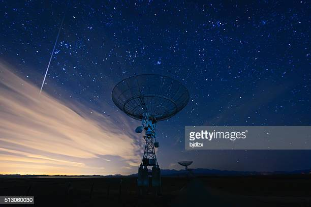 satellite dish under a starry sky - telecommunications equipment stock pictures, royalty-free photos & images