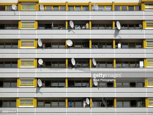 Satellite dishes on balconies of residential building in Berlin, Germany